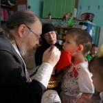 Причащение малышей в Доме ребенка
